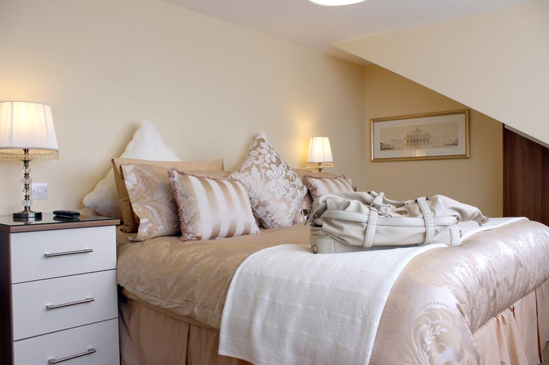 A master bedroom in one of our apartments with a luxurious king size bed