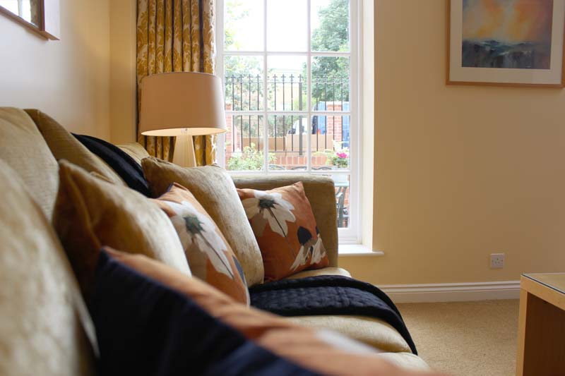 A comfy sofa in the living area of one of our business apartments