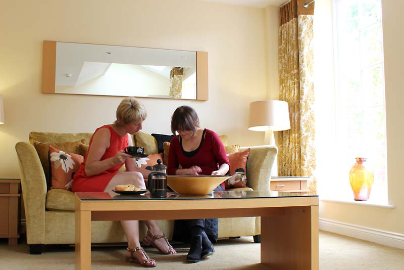 Two business people holding a meeting in one of our extended stay apartments