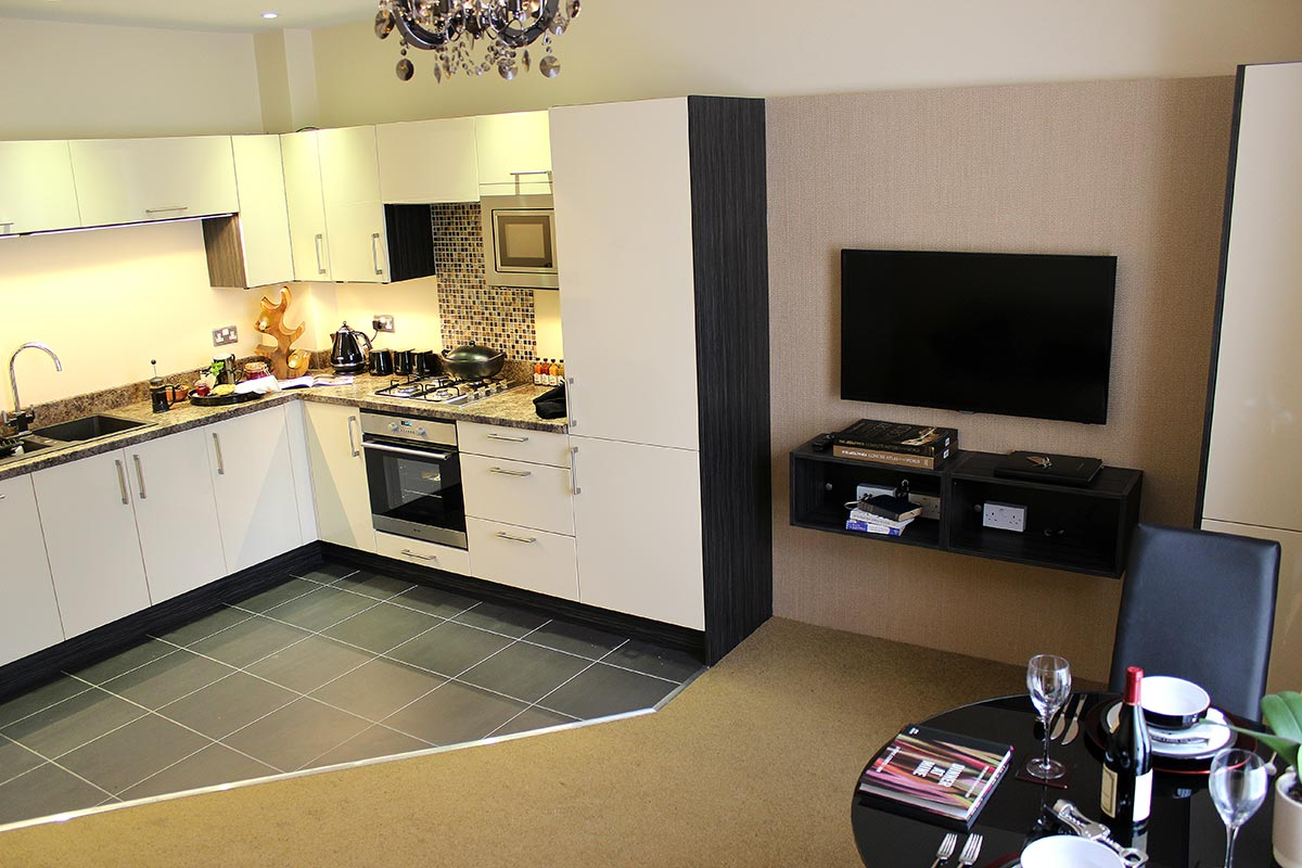 A photo of the open plan ground-floor long let apartment kitchen and living area