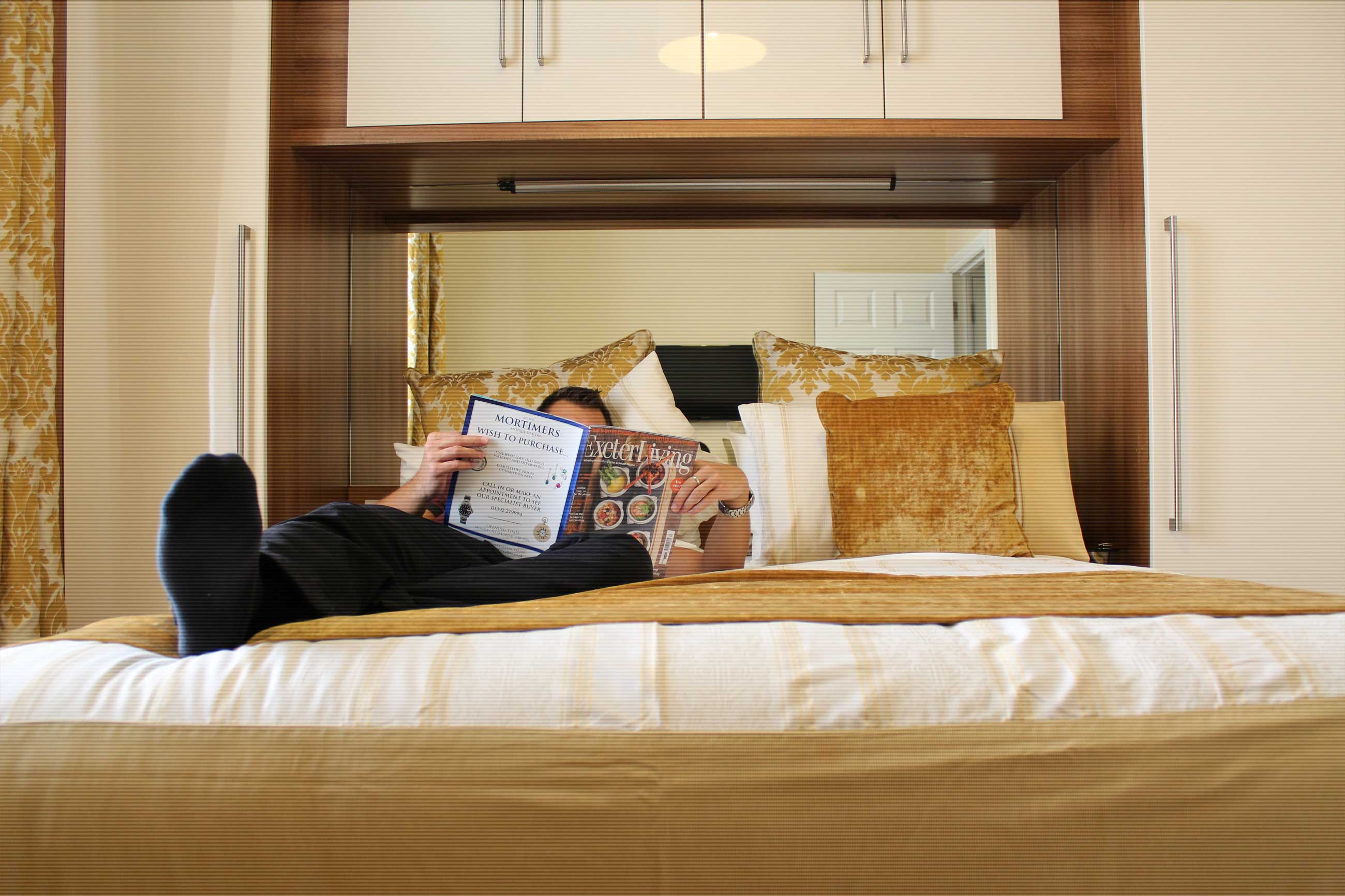 A guest relaxing on one of our large comfortable beds